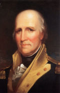 Painting of the head and shoulders of an older, gray-haired, balding man in a colonial-era military uniform (blue jacket with white lapels and gold epaullettes