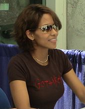 Head and shoulders shot of Berry in brown jersey and sunglasses, hair cut short, seated at an autograph table.