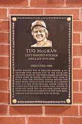 "A bronze-and-black plaque of a smiling, shaggy-haired man; the primary caption reads ""Tug McGraw"""