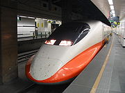 An orange and white high speed train