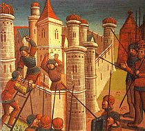 Several men with spears and shields surround a miniaturized citadel guarded by two under-equipped soldiers holding stones.