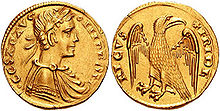 A gold coin, which depicts the bust of a man and an eagle