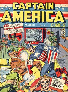 The front page of the first Captain America comic depicts Captain America punching Adolf Hitler in the jaw. A Nazi soldier's bullet deflects from Captain America's shield, while Adolf Hitler falls onto a map of the United States of America and a document reading 'Sabotage plans for U.S.A.'
