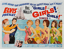 "Movie poster with Presley on the left, holding a young woman around the waist, her arms draped over his shoulders. To the right, five young women wearing bathing suits and holding guitars stand in a row. The one in front taps Presley on the shoulder. Along with title and credits is the tagline ""Climb aboard your dreamboat for the fastest-movin' fun 'n' music!"""