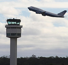 Melbourne airport control tower and united B747.jpg