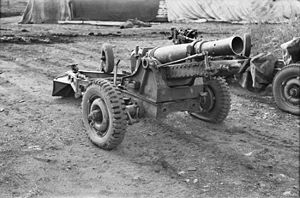 An artillery gun mounted on a wheeled gun carriage