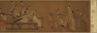 A long, horizontally oriented painting depicting fifteen people in a room. All but two of the people are adult men who are busy reading.